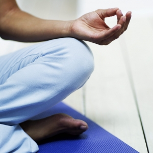 Young Woman Meditating on the Floor --- Image by © Royalty-Free/Corbis